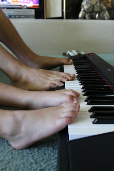 Playing-piano-together-feet